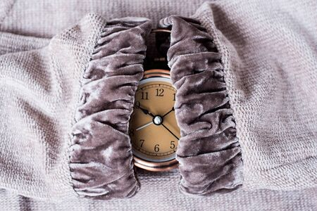 Clock at 10 O clock in the morning with vintage style alarm clock on knitted background. Windup Type Alarm Clock. Home office. Copy space