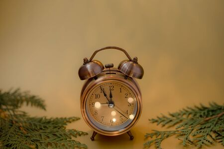 Close up of retro alarm clock on blurred Christmas background with bokeh. Copy space