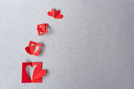 Red heart background Romantic Valentines in love sweet. Red paper hearts on grey textured paper backgrounds. Love and Valentine's day concept.