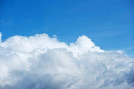 Big Cloud on blue sky nature background. Beautiful skyscape photo. Blank for design, place for text.