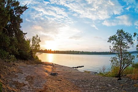 Evening landscape: sunset, the shore of the island in the Baltic Sea Bay, summer, tranquility.