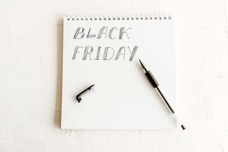Black friday autumn holiday, notepad with pen