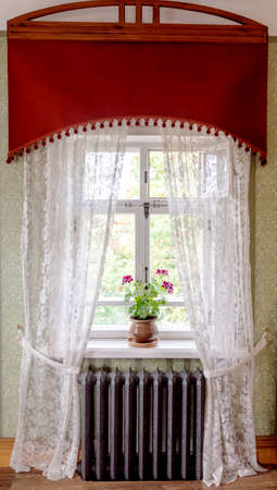 Room with window, curtains and heating battery