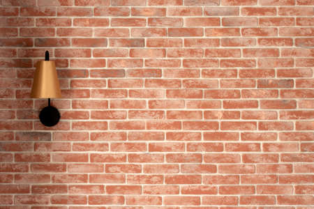 Red brick wall with lamp, copy space for text Standard-Bild