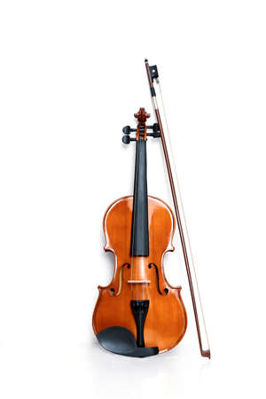 Violin and bow on white background. Classical musical instrument. Standard-Bild