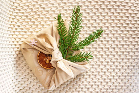 Christmas gifts and with fir branches on beige Standard-Bild