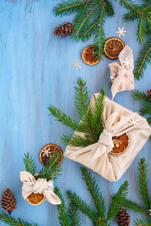 Christmas gifts and with fir branches on blue