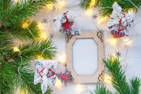 Christmas wooden frame decorated pine branches on white Standard-Bild