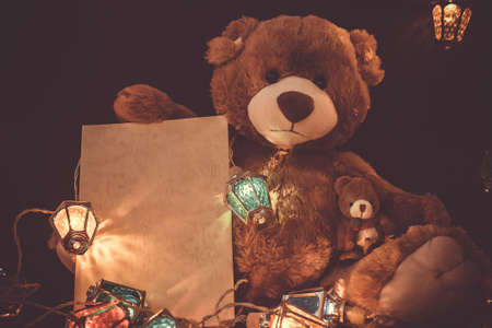 Christmas card with Teddy bear gifts and fairy lights garland. Standard-Bild