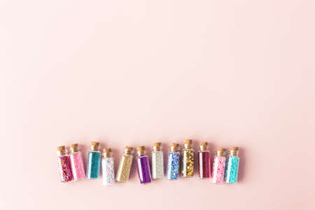 Glitter sparkling confetti in bottles copy space