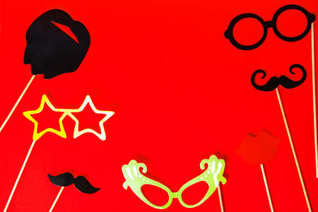 Funny masks beard, glasses, mustache on red background. Party, birthday, Halloween, Purim, Fool day concept.