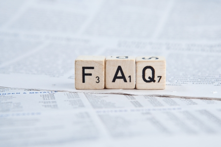 informing: Dice on newspaper - FAQ Stock Photo