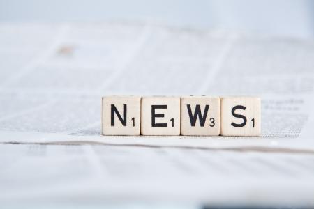informing: Dice on newspaper - News