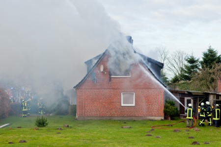 house on fire: Firefighters at house fire