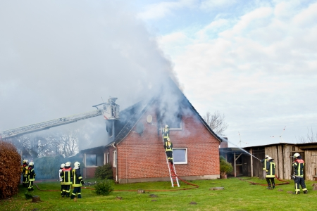 fire house: Firefighters at house fire