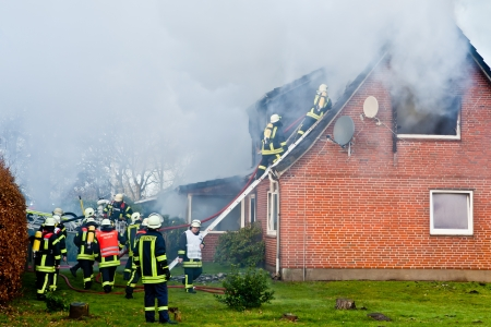 fire damage: Firefighters at house fire