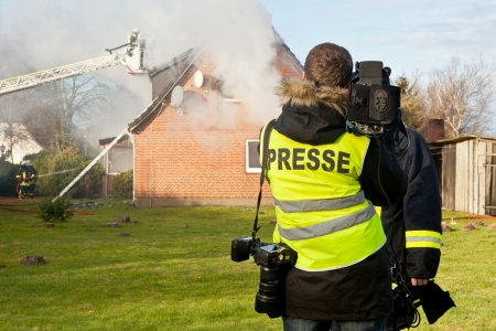 fire fighting equipment: reporter  interview at house fire Stock Photo