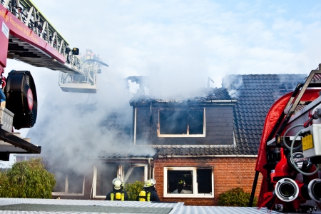 total loss: Firefighters turntable ledder at house fire Editorial