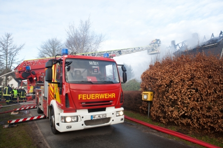 Firefighters turntable ledder at house fire Editorial