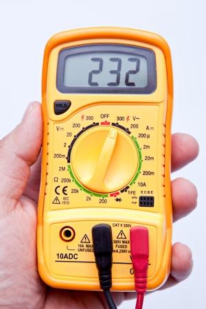 ammeter: holding digital multimeter  Stock Photo