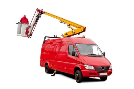 A car with hydraulic lift and a man who is working on it photo