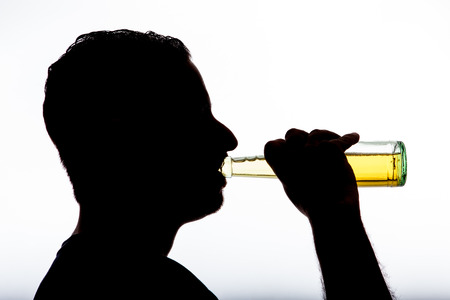alcoholic with bottle in shadow