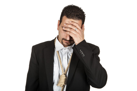 Suicidal businessman with a rope nosse around his neck