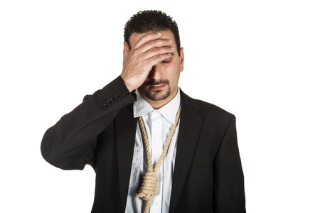 suicidal: Suicidal businessman with a rope nosse around his neck