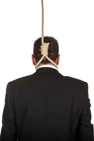 viewed from behind: Businessman with aq noose around his neck viewed from behind Stock Photo