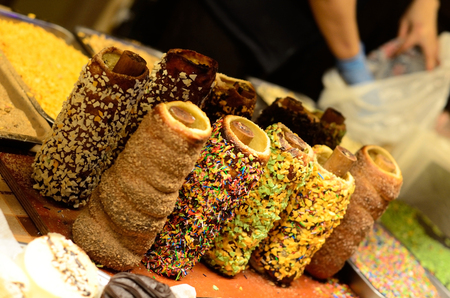 Traditional national Czech sweet street food Trdelnik, is tubes