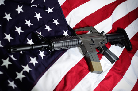 Flag of the USA with rifle Stockfoto