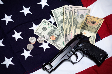 paying: Flag of the USA with gun and money