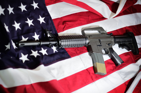 Flag of the USA with rifle Stock Photo