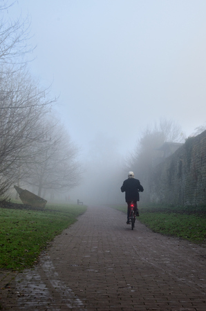 soest: Cyclist in the foggy park