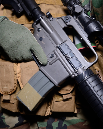 m16 ammo: Weapon Fire Selector Switch. Finger on trigger. Stock Photo