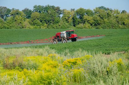 fungicide: Fertilizer machine on the field