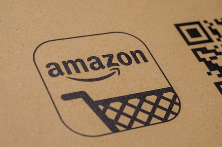 Soest, Germany - December 19, 2017: The Amazon Logo with QR code on cardboard envelope. Amazon.com, Inc., is an American electronic commerce and cloud computing company.