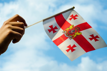 Hand with the flag of Georgia.