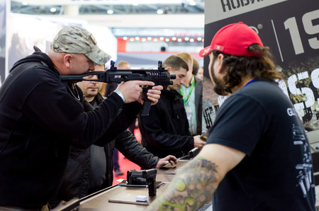 Kyiv, Ukraine - October 10, 2018: Man using weapon.  International Exhibition ARMS AND SECURITY 2018