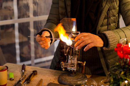 Glassblower at work. Stock Photo