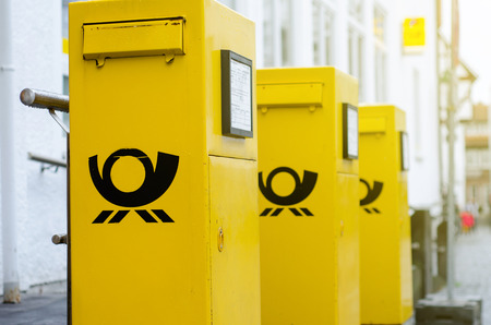 Soest, Germany - December 31, 2018: Deutsche Post Mailboxes. The Deutsche Post AG, operating under the trade name Deutsche Post DHL Group, is a German postal service and international courier service.