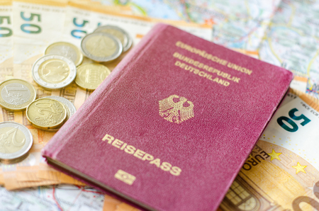 German passport with money on the map.