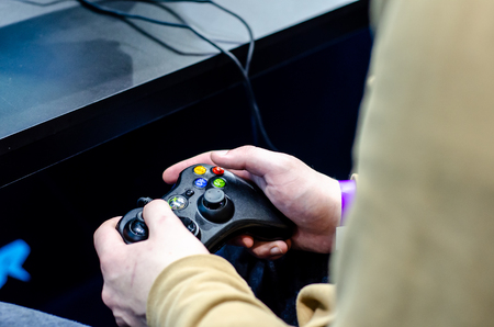 Kyiv, Ukraine - April 12, 2019: Close-up of gamepad Xbox in hand.