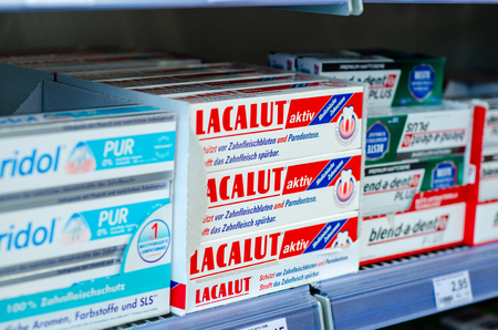 Soest, Germany - July 23, 2019: Toothpaste LACALUT and other for sale. Editorial