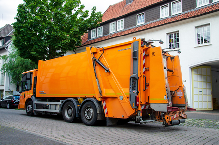 Soest, Germany - July 30, 2019: Waste collection vehicle with workers in Germany.