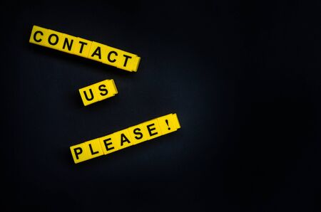 Contact Us Please word on the black background with free place for your text.