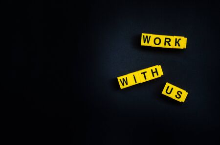 Work With Us word on the black background with free place for your text.