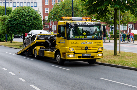 Dortmund, Germany - August 2, 2019: Widliczek tow truck loading the car after an accident.