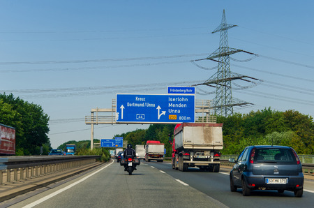 North Rhine-Westphalia, Germany - July 26, 2019: Road traffic on the German Highway (autobahn) A44 with road signs. Cars ride on the German autobahn.