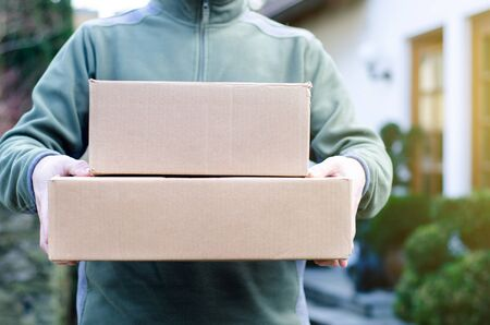 Close-up of Delivery Man Delivers Package.
